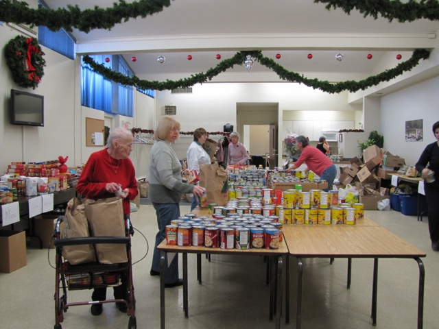 Volunteers helping sort donations which will used in the Christmas hampers